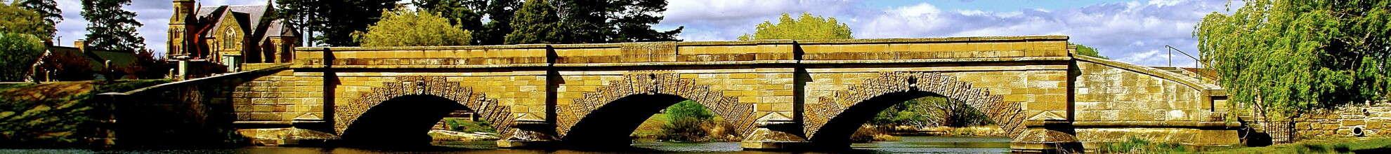 sandstone bridge in Ross Tasmania with church in background