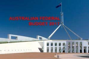 parliament house canberra with flag flying and title Australian Federal Budget 2017 for article budget highlights 2017