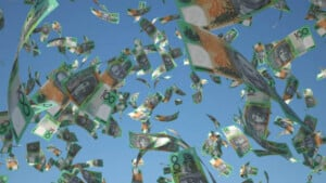 australian bank notes flying through the air having been dropped from a helicopter in managing money effort